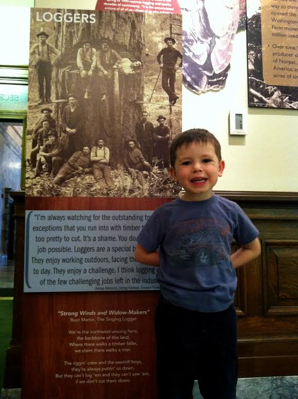 Max, standing next to a quote from his paternal Great-Grandfather in an exhibit at my office